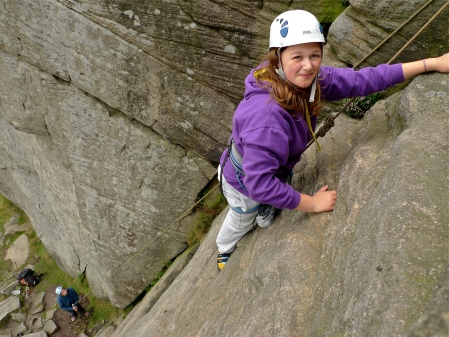 Rowan getting to grips with gritstone slabs