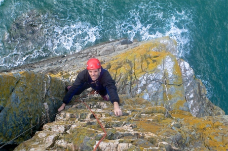 Mike on his first ever sea-cliff adventure - Lighthouse Arete